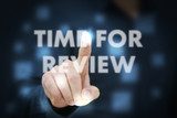 Businessman touching Time For Review