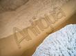Antigua written on the beach