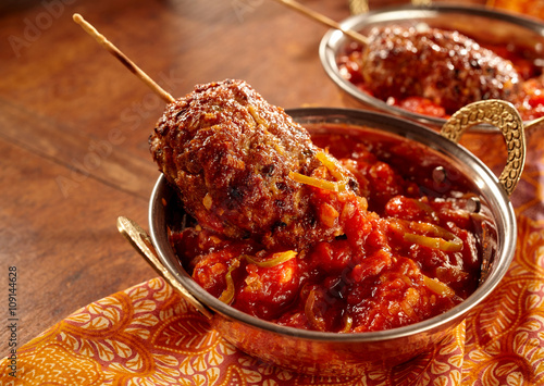 Poster Minced meat rolls dipped in hot sauce
