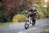 Fototapety Boy learning to ride his bike