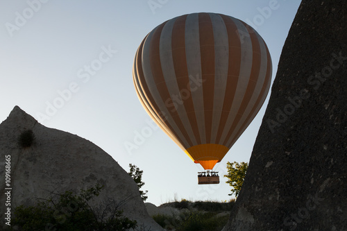 Balloon flying up between the rocks. Cappadocia. Turkey. Poster