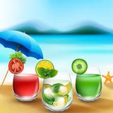 Summer drinks in sand on blurred beach background