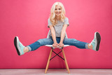 Funny blonde woman sitting on the chair