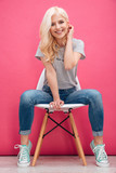 Attractive blonde woman sitting on the chair