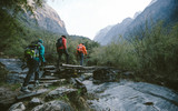 Group of trekkers cross the bridge