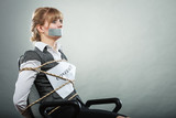 Woman bound by contract terms with taped mouth.