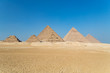 Pyramids of Giza complex ( Egypt) against the clear blue sky.