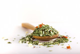 Fototapety Spoon with dried oregano and thyme, basil and vegetables