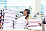 Businesswoman sleeping in office with many work