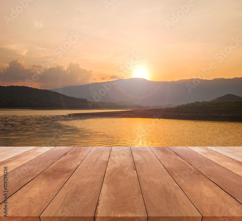 Papiers peints Morning Glory wooden table top and beautiful landscape with sunrise or sunset