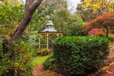 Empty beautiful gazebo in lush garden in autumn. Mount Macedon, Victoria, Australia