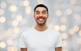 man with funny face over lights background