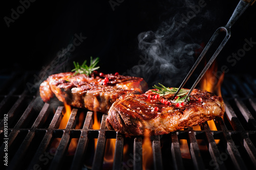 Beef steaks on the grill - 109317052