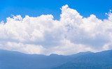 Blue sky,clouds high above mountain