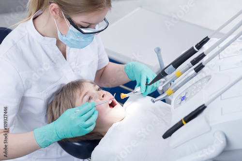 Brave little patient suffering from caries Poster