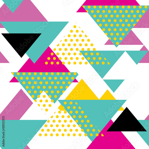 Fototapeta Seamless geometric pattern with magenta, green, yellow triangles in pop art, retro 80s style. With dot on white background.