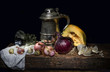 Still life with a silver stein and onions