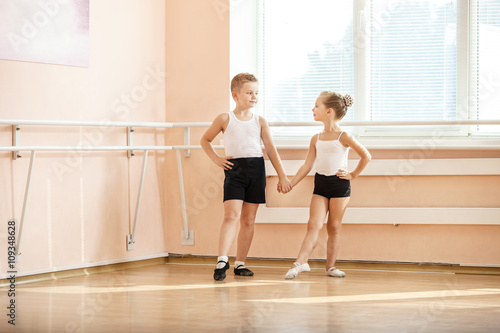 Young boy and a girl dancing at ballet class  © Andrey Bandurenko