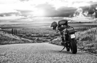 Vintage motorcycle on road adventure © MarkoVS87