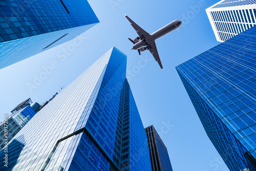 airplane over office buildings