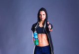 Girl with bottle in hands after sport