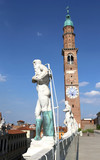 Vicenza, Italy. Ancient white stone statues of people over the B
