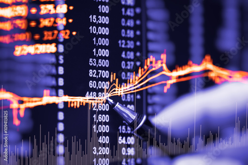 Financial data on a monitor,candle stick graph of stock market , © Phongphan Supphakank
