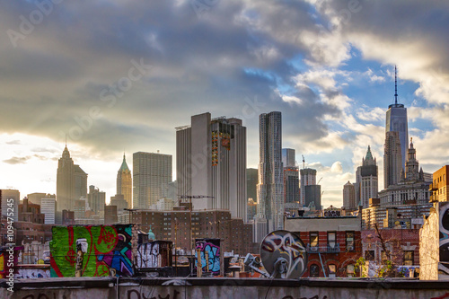Sunlight shines on lower Manhattan buildings at sunset in New York City