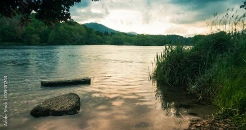 Zdjęcia na płótnie, fototapety, obrazy : A lake rocks and vegetation at Sunset