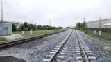 view of driving over railroad tracks toward an underpass 4k