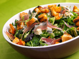 French Provencal Salad with green salad, bacon, croutons and blue cheese. Tilted view.