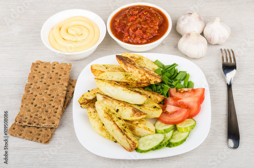 Fotobehang Restaurant Baked potatoes with tomatoes, cucumbers, bowl with ketchup and m