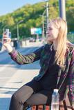 beautiful young woman doing selfie