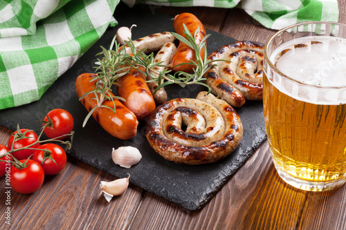 Grilled sausages and beer mug Poster