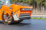 """Road roller flattening new asphalt 109574246,Green circular object and a different icons"""""""