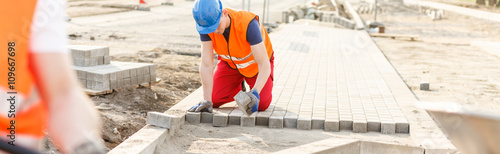Construction worker paving street