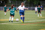 Girls playing soccer at the artificial turf field