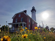 Scenic northern Michigan white lighthouse in summer evening sunlight