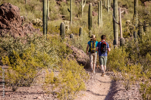 Fotobehang Arizona Two Hikers on Rugged Trail