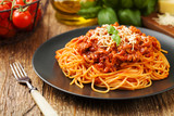Fototapety Delicious spaghetti served on a black plate