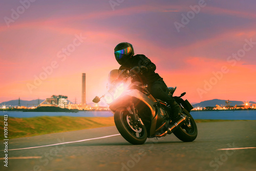 young man riding sport touring motorcycle on asphalt highways ag плакат