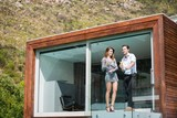 Young couple standing in balcony at resort