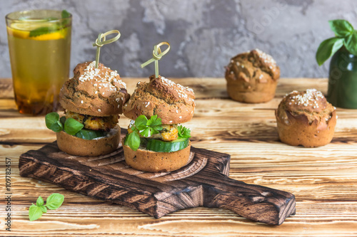 Healthy Burgers with chicken cutlet, basil and parsley, a roll of rye ...