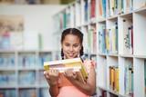 Smiling girl holding books