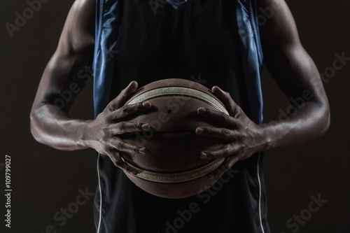 Fotobehang Basketbal Close up on basketball player holding a ball