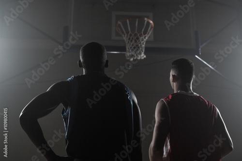 Fotobehang Basketbal Two basketball player looking the basketball hoop