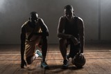 Portrait basketball players posing on their knees