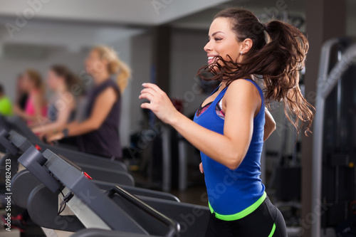 Deurstickers Jogging Beautiful brunette on a treadmill