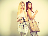 Young models with handbags.