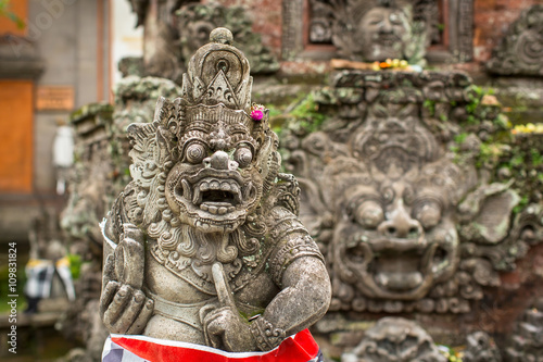 Foto op Plexiglas Indonesië Traditional demon guard statue carved in stone on Bali island, Indonesia.